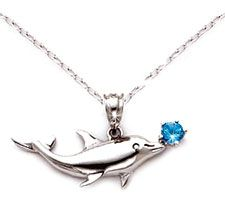 Sterling Silver Dolphin necklace with .3 carat Blue Topaz. This beautiful dolphin jewelry is Made in U.S.A.