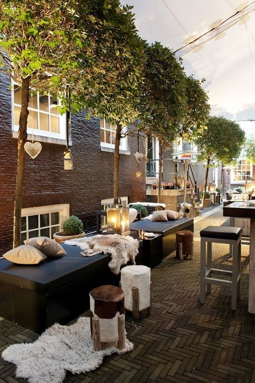 Ambiance, brick floor, trees, lighting - The Dylan Hotel, Amsterdam.