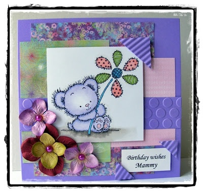 Lili of the Valley patchwork daisy. BasicGrey euphoria paper.  Prima flowers and pearls