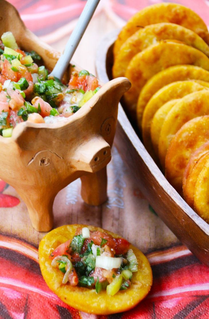 Sopaipillas con Pebre.  Find this and other traditional dishes at a COOKING CLASS from Viator. Find out more: http://www.allaboutcuisines.com/cooking-school-classes/chile/in/chile  #Chilean Food #Travel Chile #Cooking Classes Chile