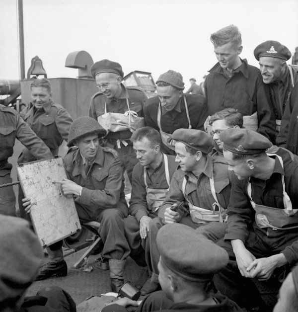 Captain S. Mendelsohn of the Royal Canadian Artillery (R.C.A.) briefing  Canadian soldiers aboard