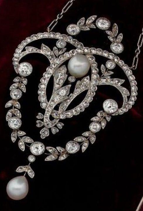 A Belle Époque diamond, pearl and platinum 'Garland' pendant, by Mellerio dits Meller, circa 1900.