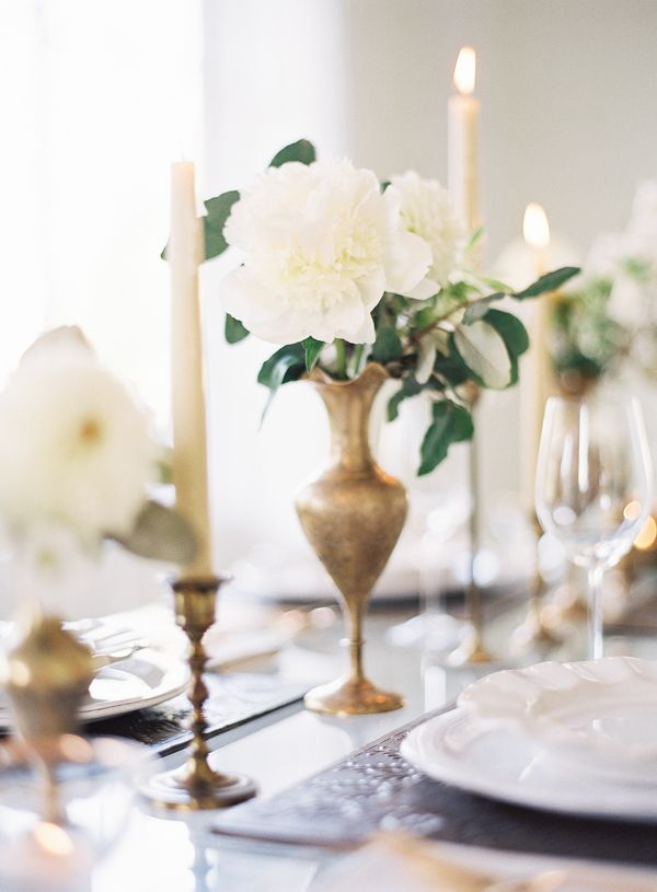 White peonies and elaeagnus in brass.   Landon Jacob Photography / Styling by Jessica Rourke