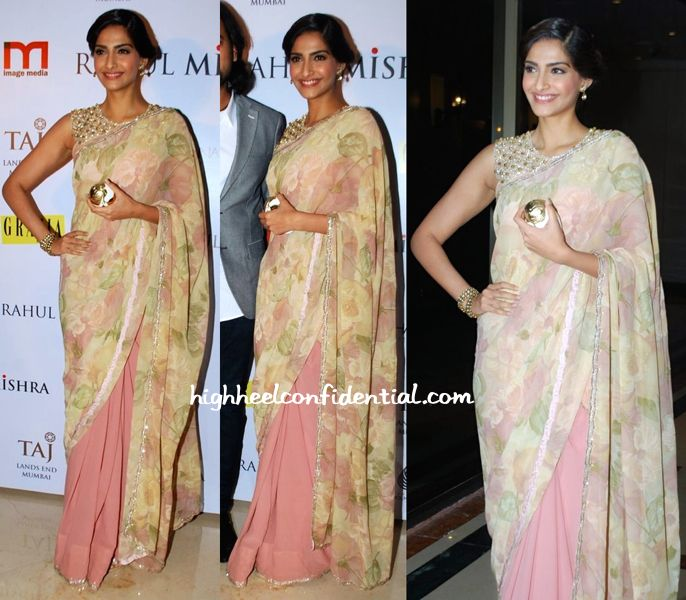 At the soirée held for Rahul Mishra, Sonam was photographed in a Shehlaa sari. Wearing her hair up, she finished out the look with small drop earrings, pair of bangles and a gold minaudière. It was her embellished bib blouse however that stole the spotlight!