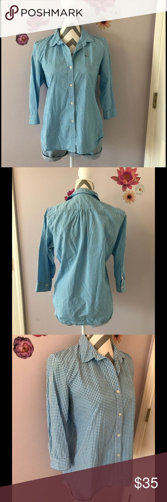 Lacoste Blue Checkered Shirt 3/4 sleeve blue and white checkered top by Lacoste. Size 42. According to Lacoste this is a size XL. Could also be worn smaller depending on how you like tops to fit. Lacoste Tops Button Down Shirts