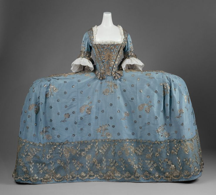 Court dress, ca. 1750. British. The Metropolitan Museum of Art, New York. Purchase, Irene Lewisohn Bequest, 1965 (C.I.65.13.1a–c) | The most remarkable examples of eighteenth-century dress had extreme proportions, appearing barely wider than the body in profile but as broad as possible in a front or rear view. The skirt of this English gown is fifty-five inches wide and was supported by panniers, or side hoops, of bent willow or whalebone covered in linen. #OneMetManyWorlds