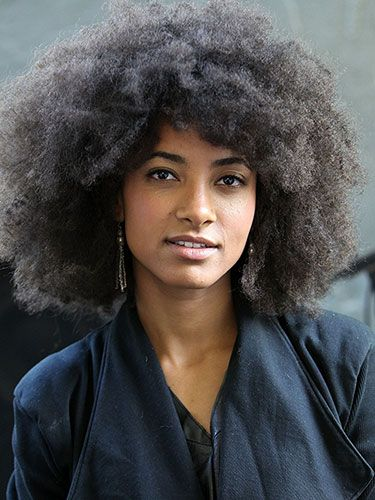 Esperanza Spalding....embracing natural texture the most important thing to remember is that moisture is a huge component to controlling your curl...