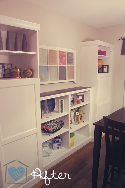 Materials: besta storage unit, billy (or, LIKE billy) bookshelves, framing nails, pre-painted white trim pieces, screws, painters caulk, hand saw and miter box, spray paint (maybe) various lengths of: 2x4's 1x12, 1x4