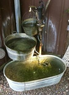 Galvanized metal or plastic horse troughs work well as easy water features, just add water.