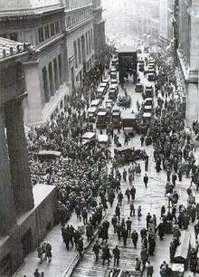 Black Tuesday, October 29, 1929: Crowds gathering at the intersection of Wall Street and Broad Street after stock market crash. The Great Depression rapidly spread worldwide. The market crash marked the beginning of a decade of high unemployment, poverty, low profits, deflation, plunging farm incomes, and lost opportunities for economic growth and personal advancement.