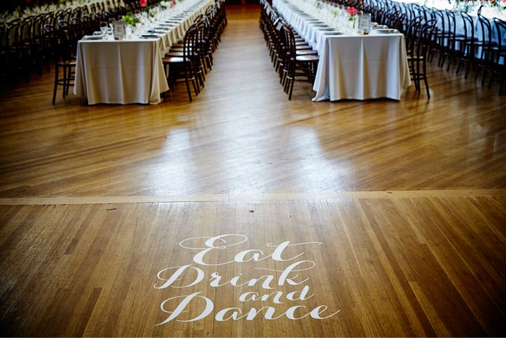 """LETTUCE & CO - STYLE. EAT. PLAY 'viv + lachy - modern art deco'. town hall transformaiton. 4 long banquet tables. bentwood chairs. floor decal. """"eat drink & dance"""". wedding reception @ northcote town hall. concept, design and wedding styling by lettuce & co"""