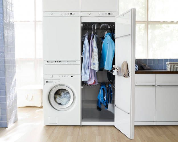 I can't begin to tell you how much I stared at this picture in Elle Decor. What is that genius contraption on the right?  Well, it's a stand up, hanging dryer. Hang your clothes, then they'll dry. What the what?!