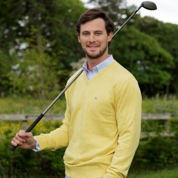 This yellow Magee jumper is a key 2014 seasonal colour and will certainly brighten up your Spring wardrobe. We use melange yarns for colour and textural interest. Features include, v-neck, rib cuff and hems and a contrasting embroidered wolfhound on the chest.