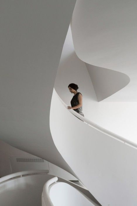 Trapezoidal residence in Tehran with sculptural staircase