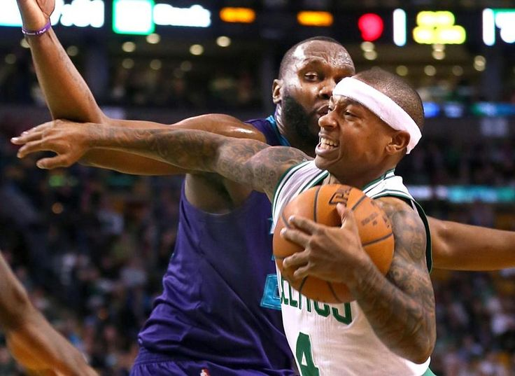 Celtics guard Isaiah Thomas (28 points) tried to fend off Hornets forward Al Jefferson on a first-half drive.