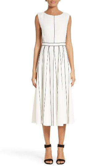 Free shipping and returns on Lafayette 148 New York Mariposa Finesse Crepe Dress at Nordstrom.com. Contrast merrow stitching creates modern definition on the fitted, darted bodice and skirt of this midi dress while cleverly creating the illusion of swingy pleats. Signature finesse crepe fabric boasts a smooth drape and wrinkle-resistant finish that takes the look from office meeting to evening out.