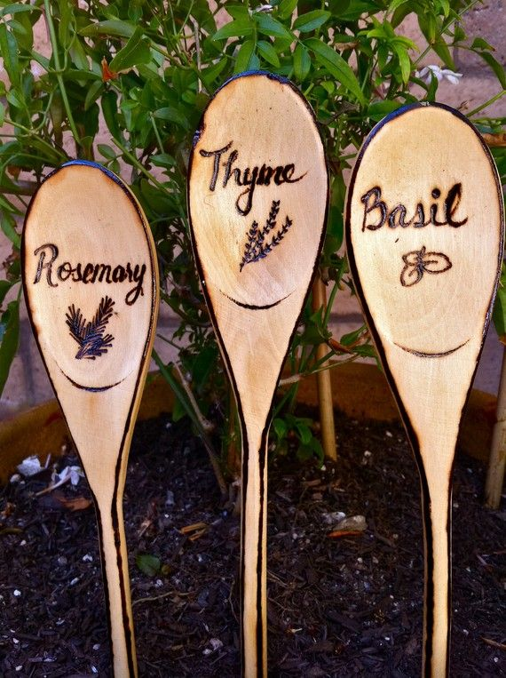 Rustic Herb & Vegetable Garden Signs, Woodburned Markers - Hear is a lovely idea for plant markers. Wooden spoons are in expensive, and they can also be written on with permanent marker! Or you can get fancy like this with a wood burner!