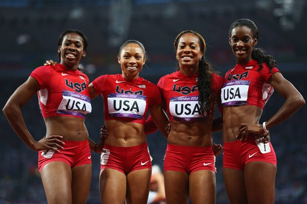 Francena McCorory, Allyson Felix, Sanya Richards-Ross and DeeDee Trotter of Team USA celebrate winning gold in the women's 4-by-400-meter relay final on Saturday. The victory gave Felix her third gold medal of the London games.