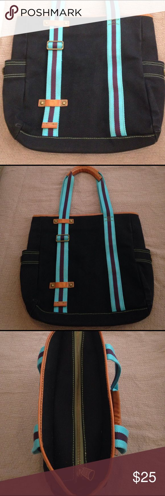 "Gap canvas and leather tote This Gap black canvas tote is a part of the 1969 collection. It is a large bag with two side pockets and a few pockets inside including a zipper pocket. This bag is in good shape and there is no tears or stains. The straps are adjustable. Width is 13.5"" and in length 14"". Gap Bags Totes"