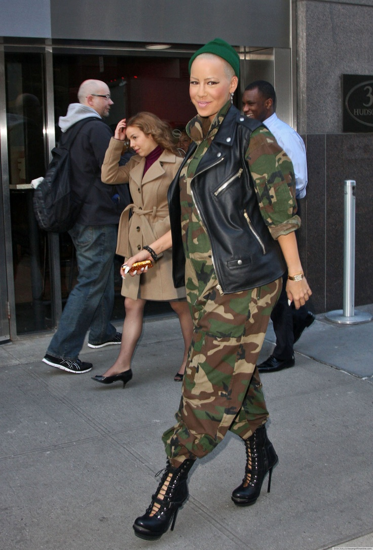 Amber Rose is widely known for her subtle, demure fashion, so we're totally shocked that she went out recently in a head-to-toe camouflage jumpsuit.