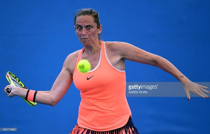 Eyes on the ball... Roberta Vinci of Italy hits a return against Ukraine's Kateryna Bondarenko in the women's first round at the Brisbane International tennis tournament in Brisbane on January 2, 2017. / AFP / SAEED