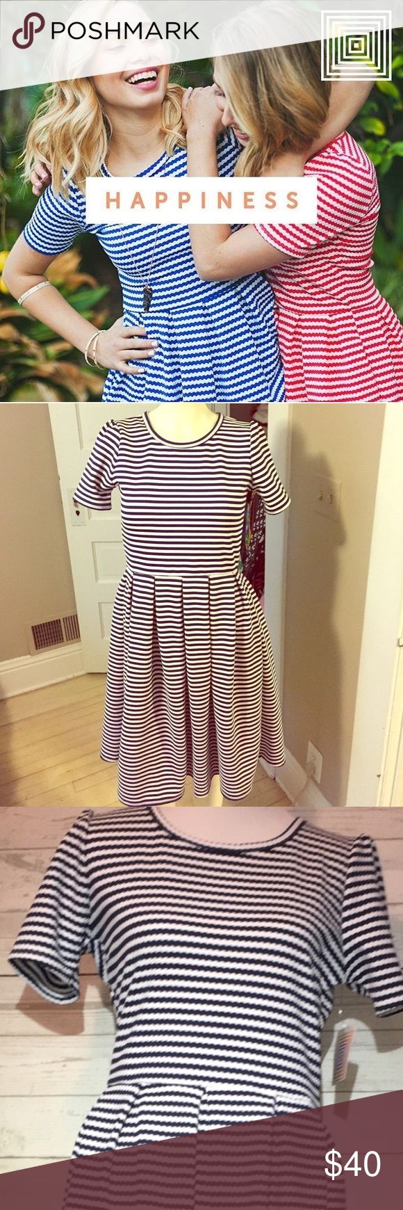 "🦄LulaRoe Amelia blue & white dress🦄 Blue and white Amelia dress. Has two front side pockets in the skirt. Has six pleats at the skirt which give it shape and structure. Has a crew neckline. Zips up the black, zipper goes into the skirt. Dress measures 33"" sleeves measures 81/2""and the skirt measures 22"" no odors. Bookmark me @kujijoy thanks for looking! LuLaRoe Dresses Midi"