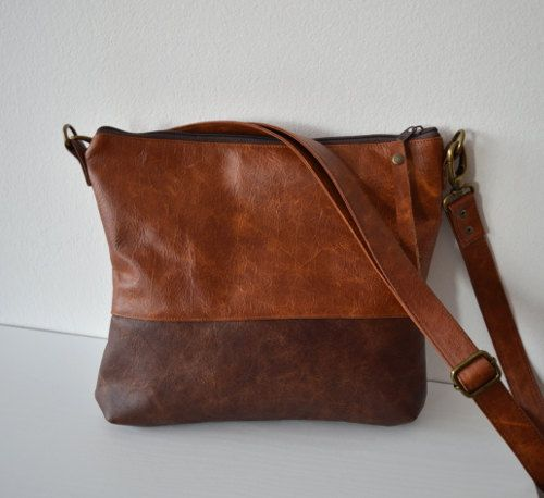 This medium crossbody bag is handmade of distressed genuine leather in two-tone brown.  Its made of supple cowhide leather.  Perfect everyday bag.