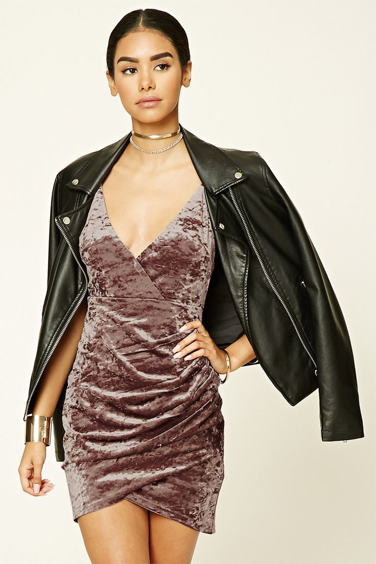 A crushed velvet bodycon dress featuring a surplice front with a snap-button closure, adjustable spaghetti straps, a ruched side, and a concealed back zipper.