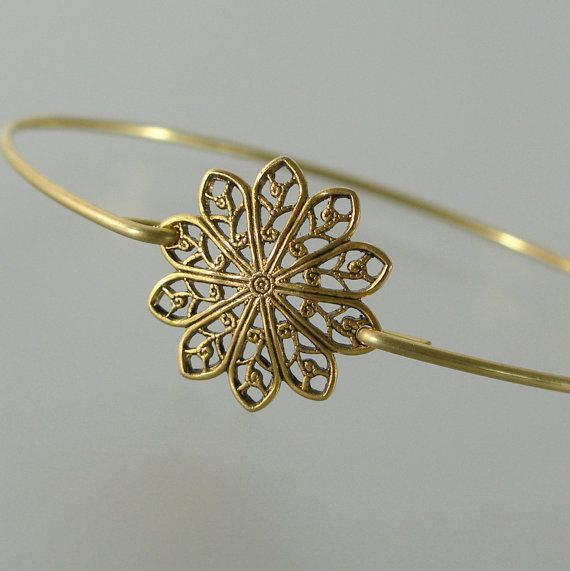 Hey, I found this really awesome Etsy listing at https://www.etsy.com/listing/152943539/gold-round-filigree-bangle-bracelet-gold