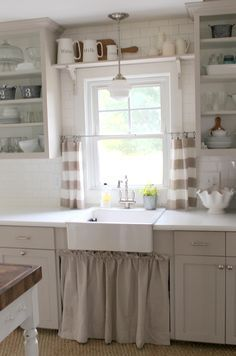 Love the open shelving & cabinet curtain under the sink
