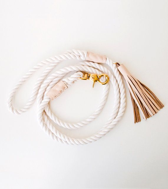 Dog leash made from 3 strand cotton rope, accented with pretty blush / nude leather. Its the classic rope dog lead, in a minimalist form, with a little bit of style and saltiness. Sturdy hand-tied eye splices, traditionally used by sailors, are used here to secure the handle and clasp loops. The splices are covered with clean leather bands, also elegantly hand stitched on, using double stranded mercerized cotton cord. F E A T U R E S  - 3/8 cotton rope thats both strong & soft -...