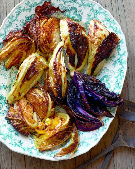 Add some festive color to the meal with a mix of red and green cabbage. Cut into hefty wedges, the cabbages get a crispy charred edge in the oven.