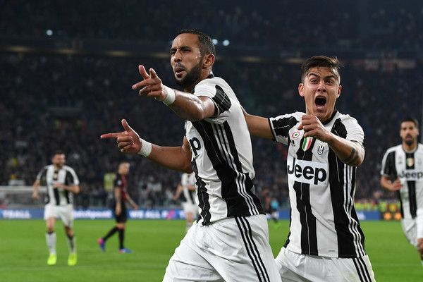 Medhi Benatia (L) of Juventus FC celebrates after scoring the opening goal with team mate Paulo Dybala during the Serie A match between Juventus FC and AC Milan at Juventus Stadium on March 10, 2017 in Turin, Italy.