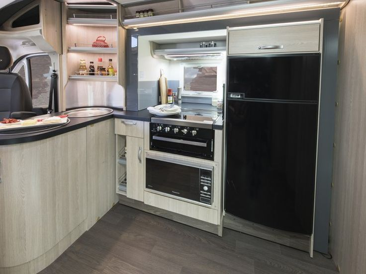 The kitchen area in the B7663SL Eyre motorhome is located within a slideout room that opens and closes at the press of a button. Having the slideout room opened whilst the vehicle is parked dramatically increases the living area inside the motorhome.