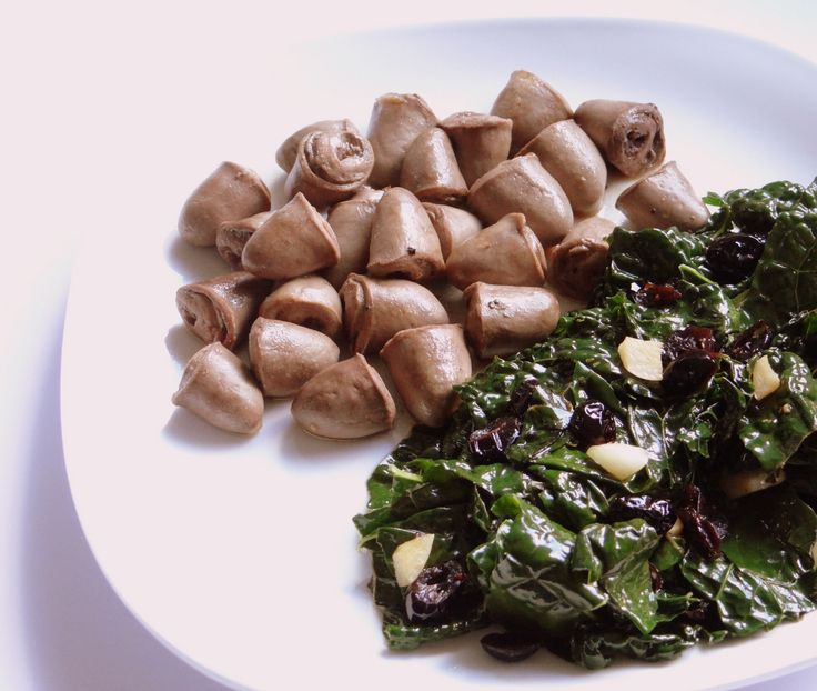 Simple Marinated Chicken Hearts Recipe - photo of chicken hearts & kale with cranberries  ** In this recipe the hearts are tender, full of delicious flavor, and easy to prepare **