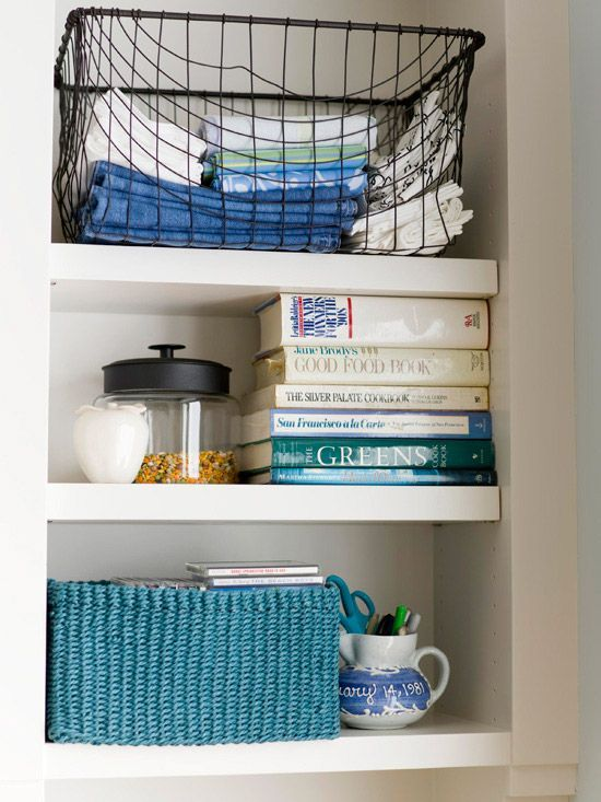 Solutions for Linens  Run out of drawer space for towels and cloth napkins? Reach for a basket to neatly stack linens and tuck the basket onto a shelf or inside a cabinet. A basket will help keep linen sets together and will be easy to find when you want to use them.    Would be great for that usually dead space above the kitchen cabinets