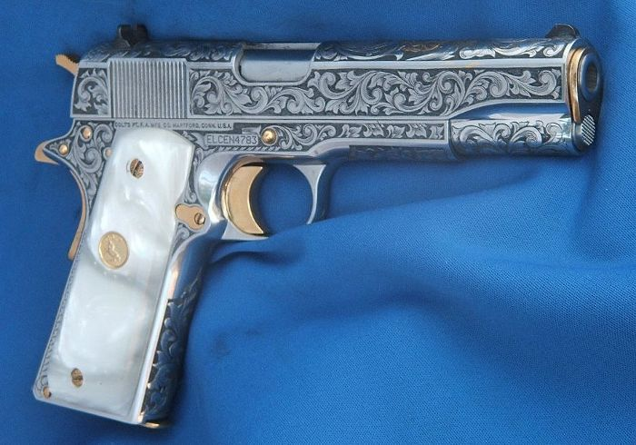 Engraved Colt 1911 Pearl Grips I really want this's!!!! Find our speedloader now! http://www.amazon.com/shops/raeind