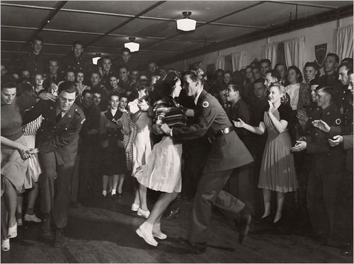 Soldiers and their girls jitterbug at a National Guard service club in Hattiesburg, Mississippi, 1941. Photo by J Baylor Roberts for the National Geographic Society.