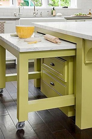 Kitchen Island pull out. One with marble for baking and one with a vutting board in the second island. Good for kids