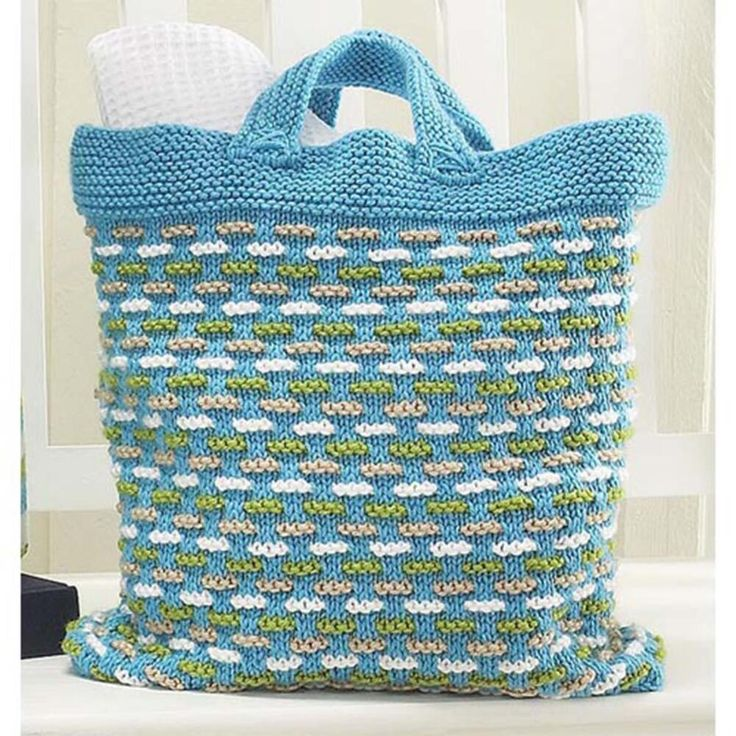 Basket Weave Bag for summer. Trendy turquoise bag woven with lime, white, and tan accents is the perfect size for toting all of your supplies to the beach or as a fun tote for your summer vacation.