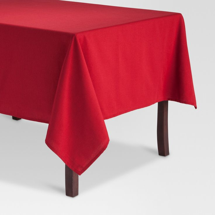 Give your dining room a warm and inviting update with this Solid Tablecloth from Threshold™. The circular tablecloth has a simplistic and clean design with a subtle ruffle as it drapes toward the ground. Use this modern tablecloth to bring effortless style and warmth to your modern dining room. Dress your table up in this bold red tablecloth for family dinners or holidays along with a festive centerpiece for a look that's uniquely your own.