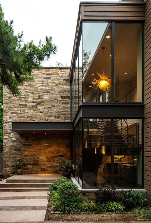 love the contemporary look of this home the stonework and marvelous glass windows with black trim simply the best: