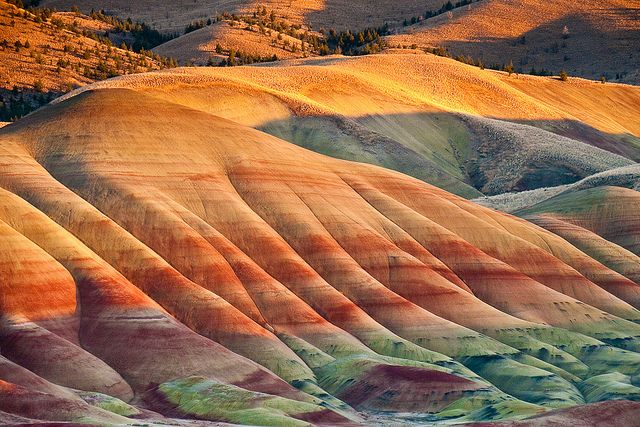 Painted Hills, John Day Fossil Beds National Monument, OR by Keith Skelton: The striking striped hills are a geological record of flood plains of various eras. The fossil beds are rich in remains of ancient horses, camels and rhinoceroses. http://tinyurl.com/3pmo9vl  #Painted_Hills #Oregon #Keith_Skelton