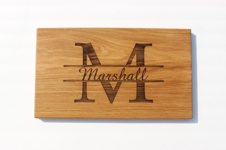 A classy and beautiful addition to any kitchen, this custom engraved cutting board is personalized with the monogram of the recipient and the family name or couple's names running through it. Each boa