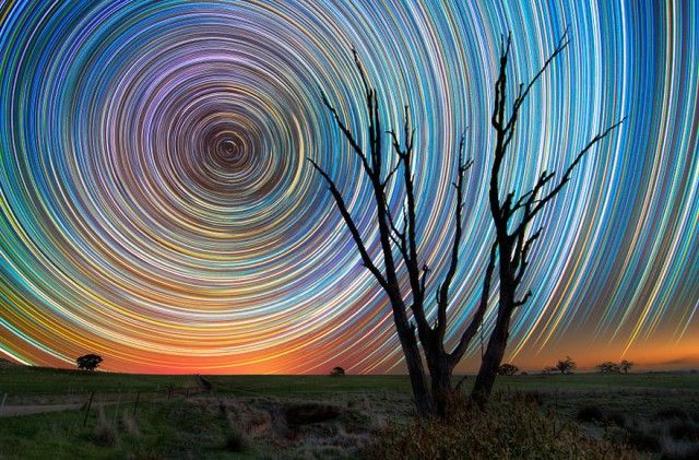 The star swirls are the result of the rotation of the Earth, and make you think you're witnessing the stars traveling across the sky. By Lincoln Harrison.