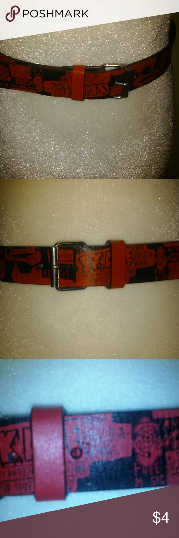 """TARGET Juniors Black And Red Belt Skater.Small Cute Junior's faux leather belt from Target.  It is 1 1/4"""" thick with a silver clasp and red and black SKATE cartoon themed design.  Pre-owned and in good condition.  There is a hole that was made directly in the middle of the belt.  It has 5 clasp holes and measures 33 1/2"""" long.  It is a size small and will fit a size 28"""" and lower waist.  Please view pictures. Thanks for looking! Target Accessories Belts"""