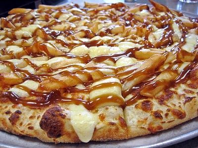 poutine pizza, smothered in french fries, gravy and cheese curds. Whoa!
