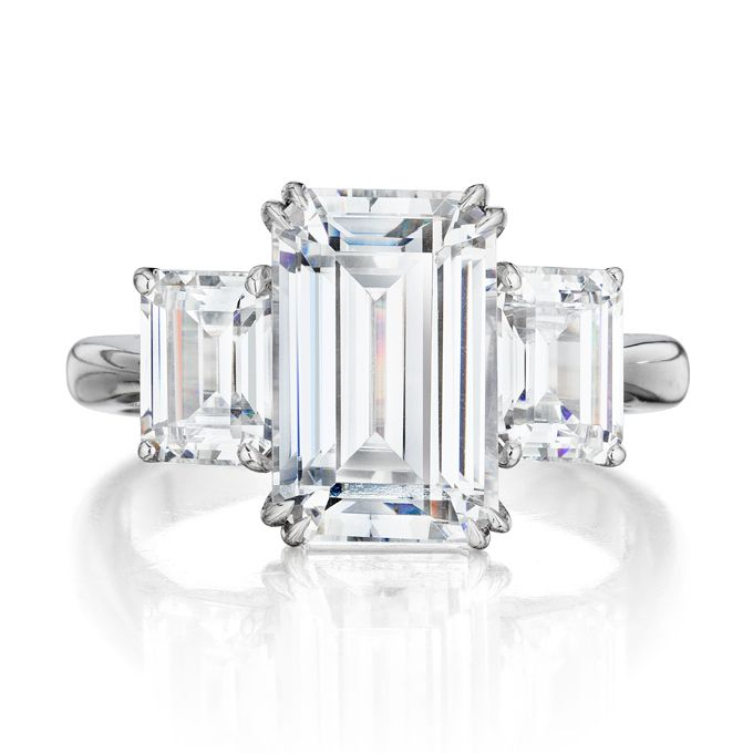 "Brides.com: . ""Chloe"" Leo Ingwer Signature Collection handmade three-stone platinum engagement ring with 3.47 carat total weight emerald-cut center diamond ring and emerald cut side stones, price upon request, Leo Ingwer"
