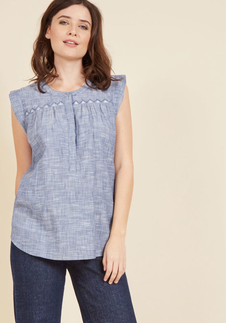 <p>If the charge is loving this slate blue top from Mata Traders, consider us guilty! Feminist-minded Mata Traders fights poverty through the employment and empowerment for the craftswomen in India and Nepal who create their fair-trade, handmade products - like this cotton blouse, whose cap sleeves, concealed placket, and triangular embroidery are elements we can't deny adoring.</p>