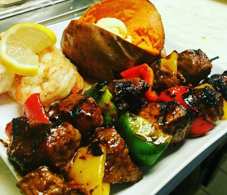Photo: Marinated Steak Kabobs, Shrimp Scampi, Baked Sweet Potato